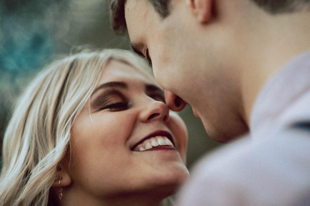 Tuscany Engagement Session - Couple hugging, beautiful female smile