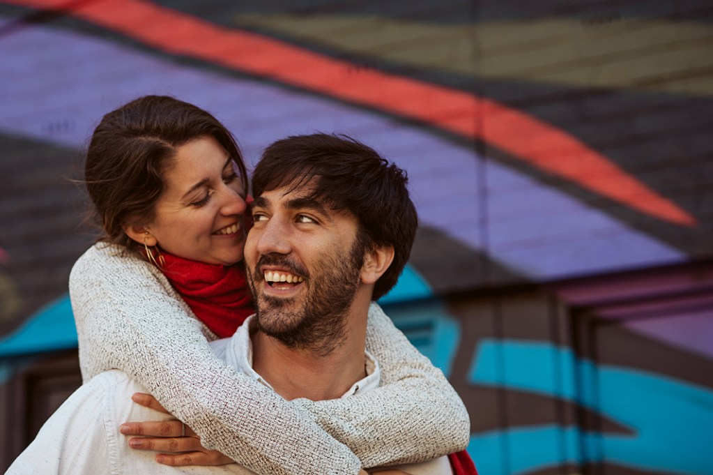 Brussels Engagement Session - couple hugging, street art in the background
