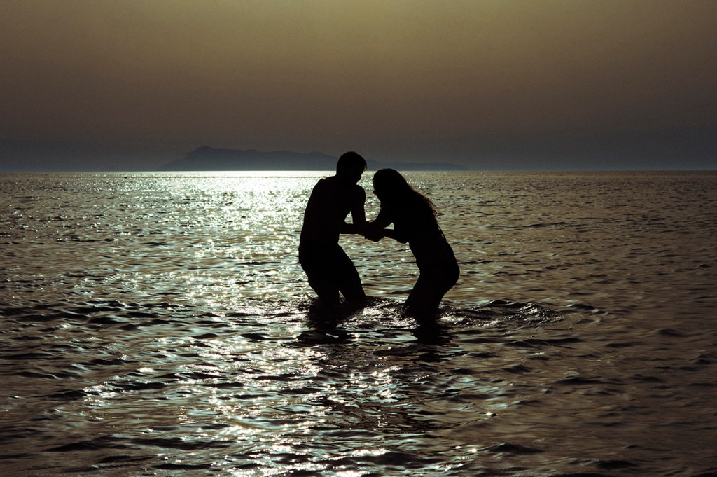 Greece Destination Engagement - Corfu - silhouette of a couple playing in the sea