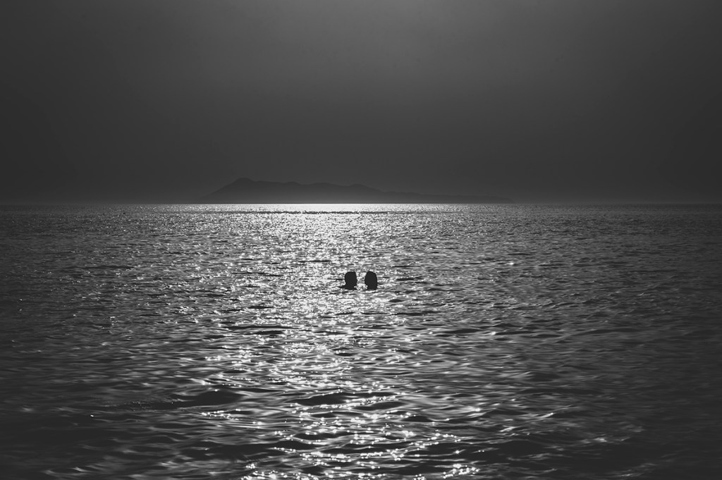 Greece Destination Engagement - Corfu - silhouette of a couple swimming in the sea