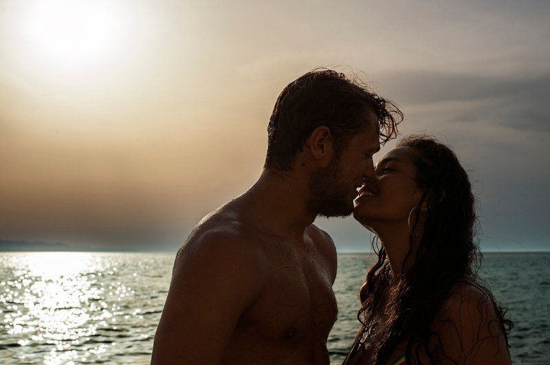Greece Destination Engagement - Corfu - kiss with sunset background on the beach