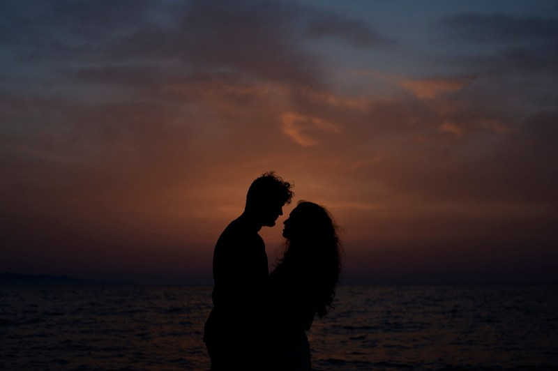 Greece Destination Engagement - Corfu - Silhouette of a couple hugging and looking at each other