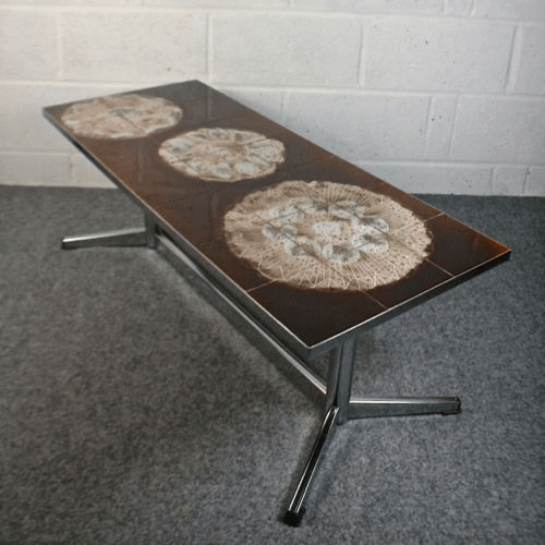 a 1960s abstract tiled top coffee table with chrome legs