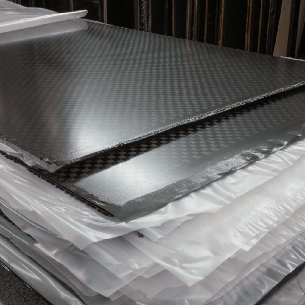Pressed carbon fiber flat sheets using aerospace trim scrap