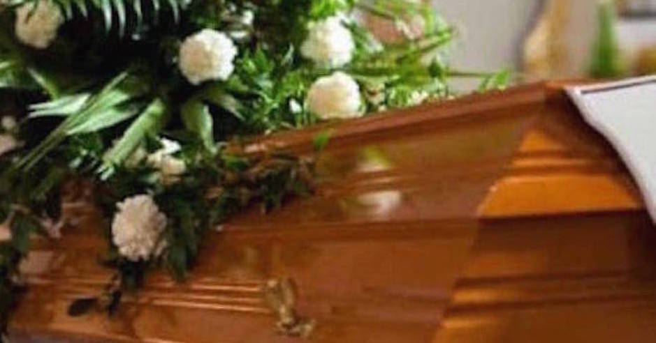 Flowers on a coffin in the church