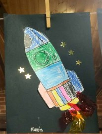 Photograph of a painting of a rocket, by Alexis, aged four.