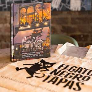 Relish book and tote bag in restaurant