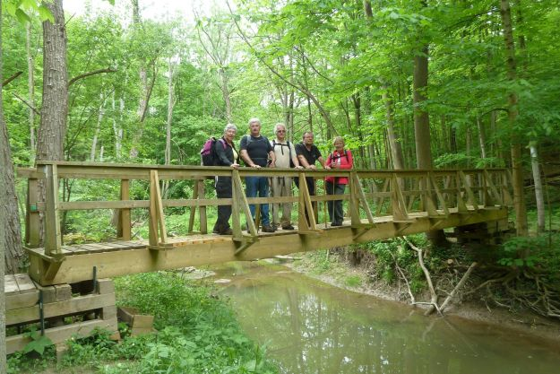 Group posing on great bridge Thames Valley Trail Club built for everyone's enjoyment.