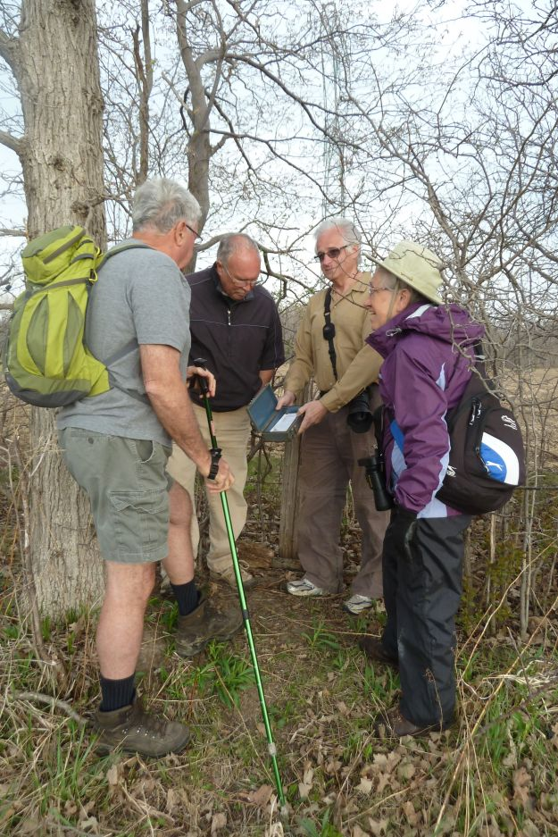 Mark showing a geocache to hikers from West Elgin Nature Club.
