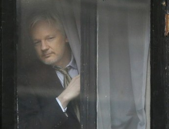 Wikileaks founder Julian Assange appears at the window before speaking on the balcony of the Ecuadorean Embassy in London  Friday  Feb  5  2016  A U N  human rights panel says WikiLeaks founder Julian Assange  who has been squirreled away inside the Ecuadorean Embassy in London to avoid questioning by Swedish authorities about sexual misconduct allegations  has been  arbitrarily detained  by Britain and Sweden since December 2010  The U N  Working Group on Arbitrary Detention said his detention should end and he should be entitled to compensation   AP Photo Kirsty Wigglesworth