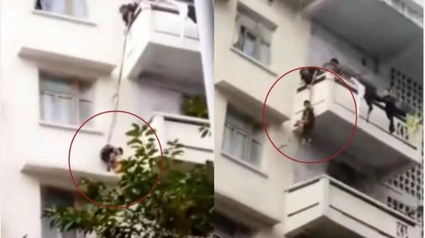 Mujer cuelga a su nieto de quinto piso para salvar a su gato(Captura de video)