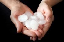 hands-holding-hail-damage