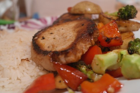 pork chop with sticky barbecue sauce, brocolli, peppers and potatoes