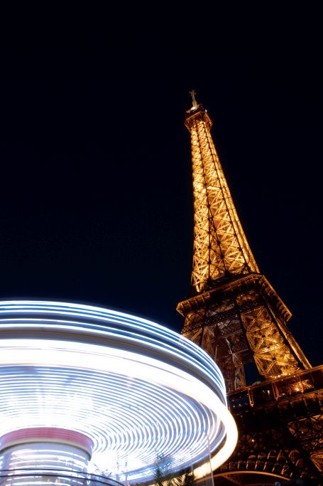 Merry go round and Eiffel Tower at night