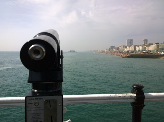 Viewfinder on Brighton Pier looking out to the West Pier and beach