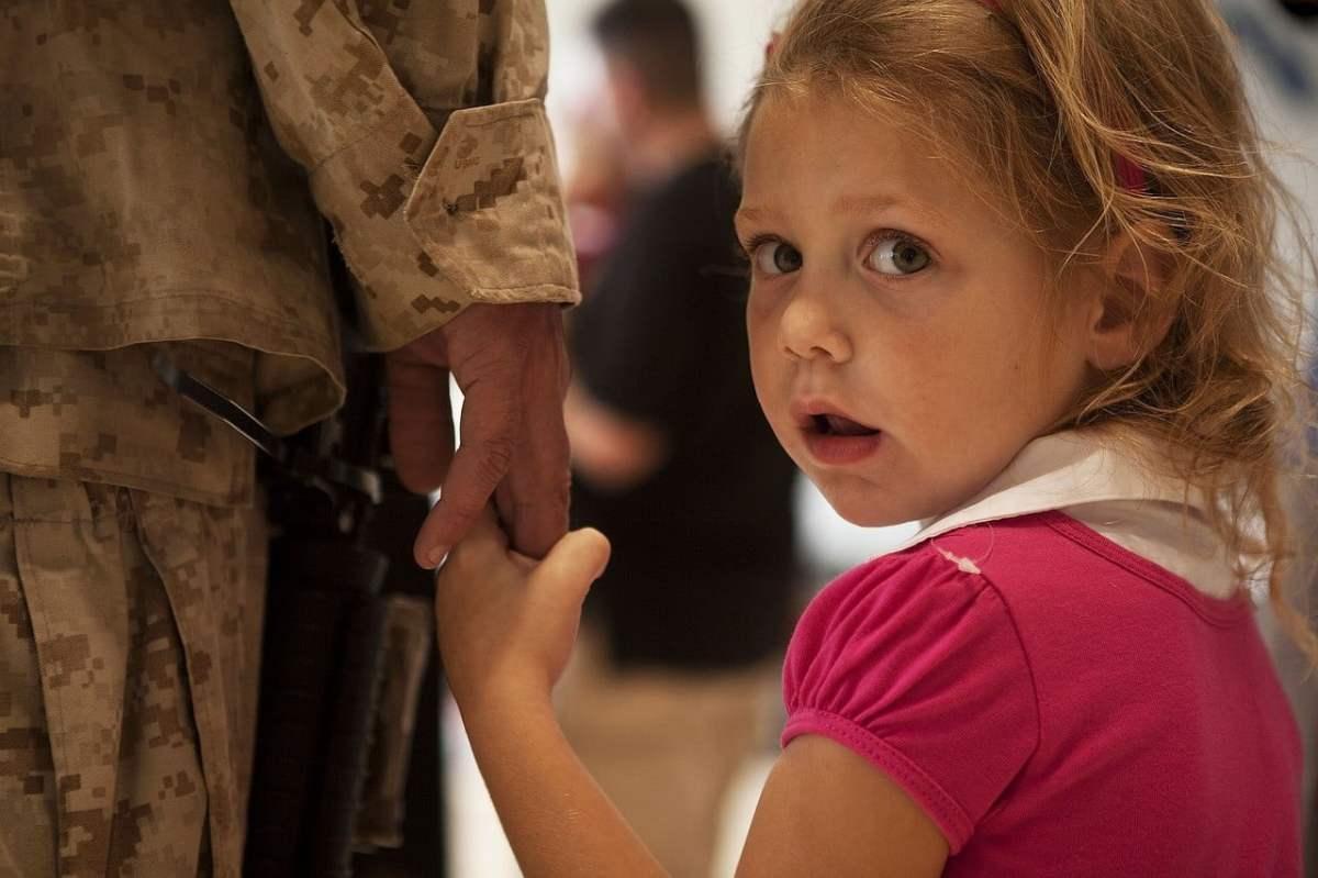 parent holding child hand photo