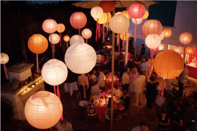 chinese-lanterns-with-ribbons-hanging-down-on-patio-reception