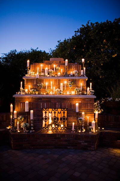 Outdoor Fireplace Decorated With Candles Wedding Decor