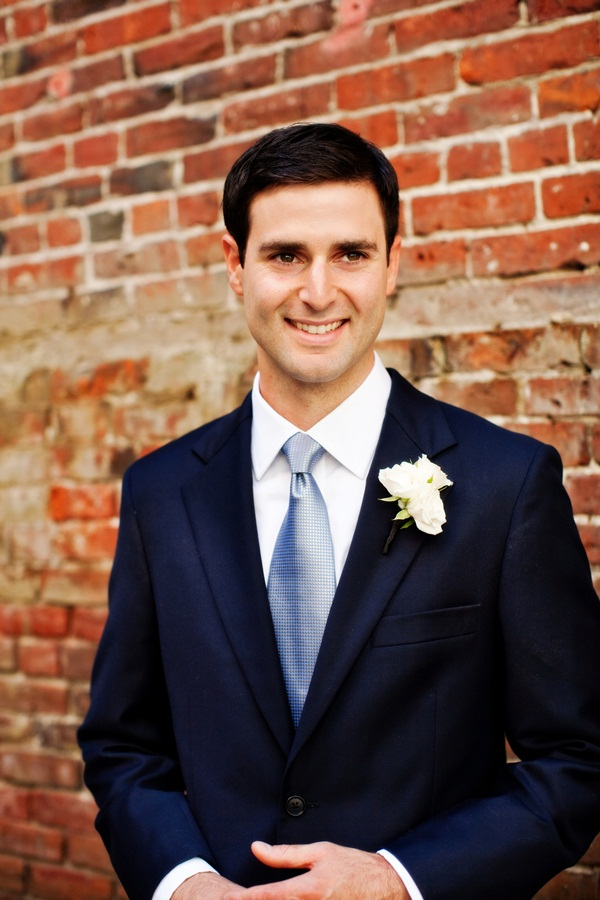 navy blue grooms suit with light blue tie