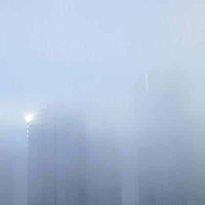 building hidden by mist fog
