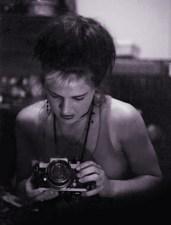 Elizabeth Montague with SLR camera 1985