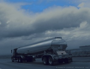 Truck Mirrors Storm Clouds on the Freeway