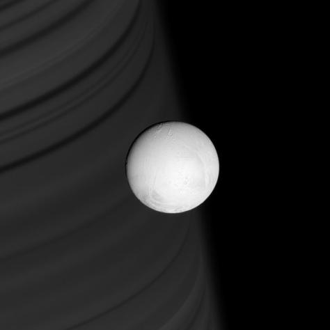 Enceladus with Saturn in the background