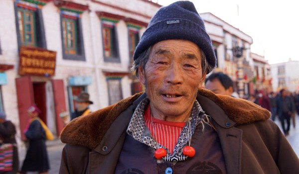 Lhasa: portrait of a pilgrim at Barkhor Street