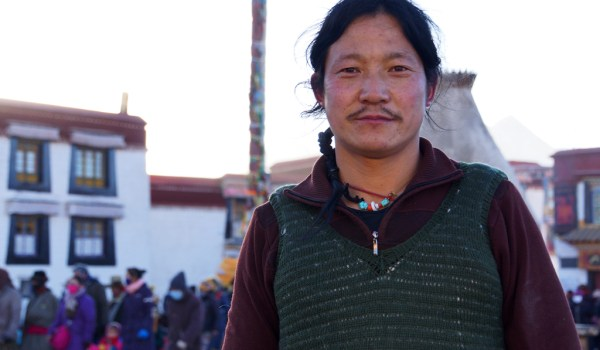Lhasa: portrait of a pilgrim at Barkhor Square