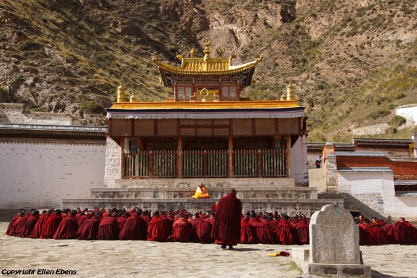 Labrang Monastery, Xiahe: monks gathering for a prayer service at the court yard
