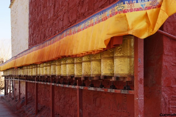 Prayer wheels at small monastery near Gonkar Airport