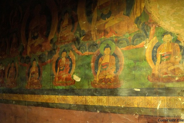 Old murals inside the assembly hall of Zhatang Monastery