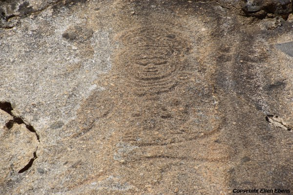 Religious carving in the rock of the mountain slope at Densatil Monastery