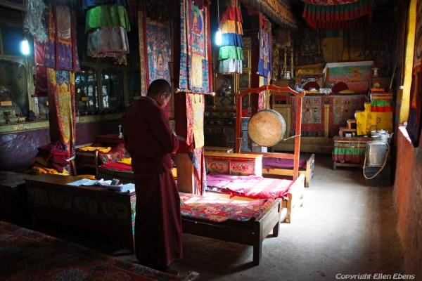 Inside Densatil Monastery, religious books