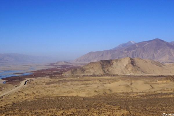 Crossing a pass while driving from Tsedang to Samye. View from the pass.