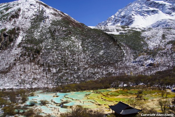 Huanglong NP with snow on the mountains
