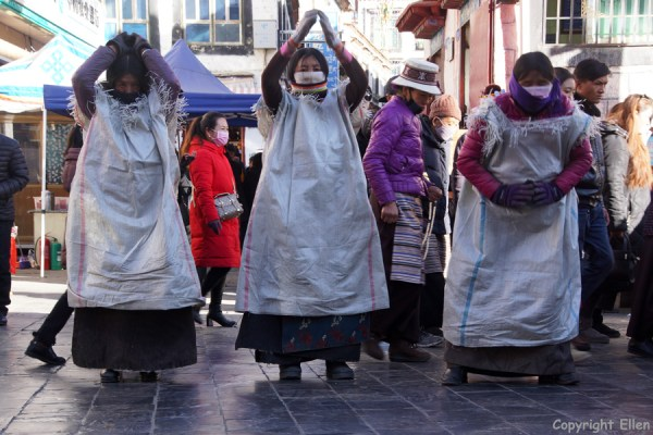 Prostrating pilgrims at the Barkhor around the Jokhang Temple, Lhasa