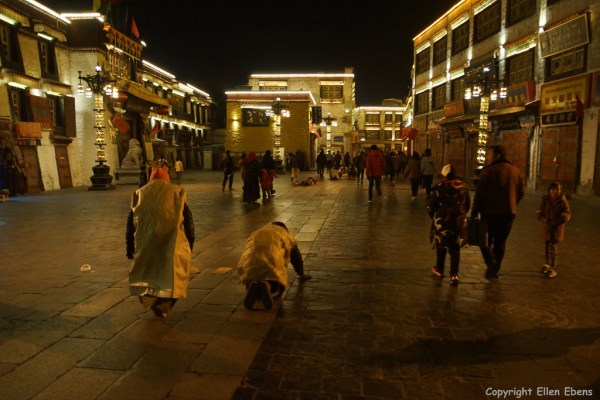 Prostrating pilgrims in the evening at the Barkhor around the Jokhang Temple, Lhasa