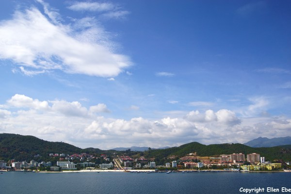 The shore line of Fuxian Lake seen from the island. It's quicly developing into a beach resort.