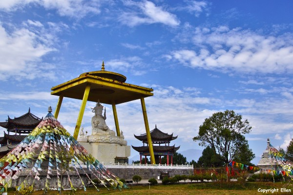 The Tibetan Golden Stupa and temple complex in a park at the outskirts of Lijiang. Statue of Padmasambhava.