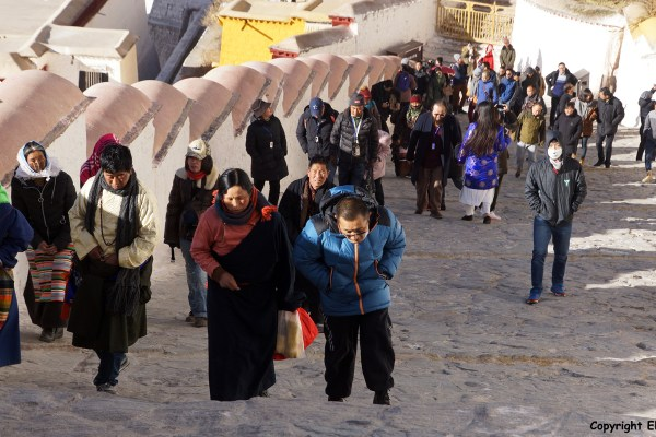 Lhasa, pilgrims climbing up the stairs to the Potala Palace.