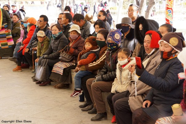 Lhasa, people looking at the dancing in the park behind the Potala Palace.