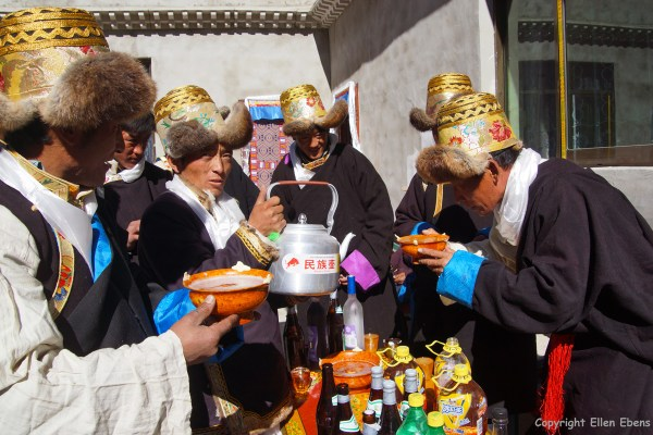 Tibetan families celebrating farmers new year at the court yard of a home.
