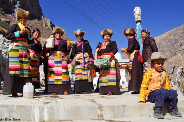 Tibetan women celebrating farmers new year at a stupa.