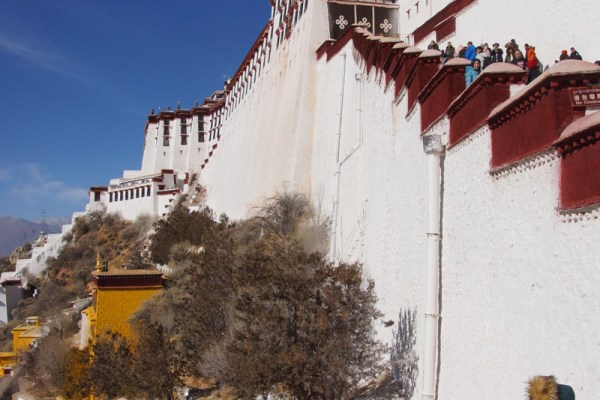 Pilgrims climbing up the stairs to the Potala Palace, Lhasa