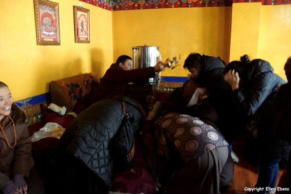 Receiving a water blessing at he Temple of West Three Protectors (The Western Rigsum Lhakhang)