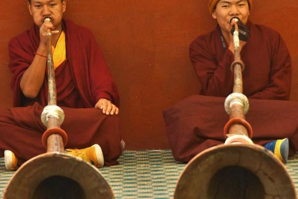 Nangchen monastery monks long horns