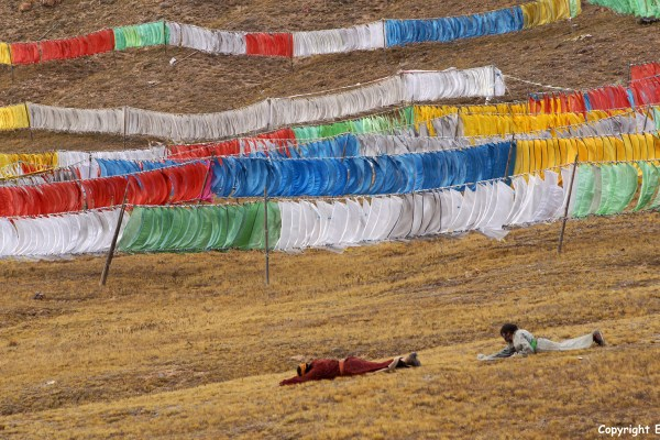 Amdo stupas prayer flags pilgrims prostrating