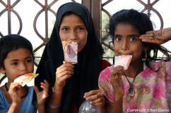 Girls enjoying an ice cream at the city of Bijapur