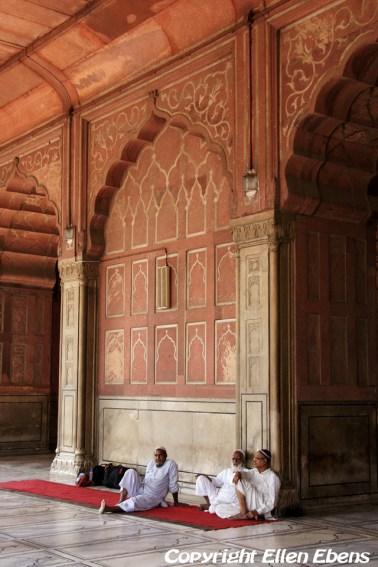 Three men relaxing in the Jama Mashid Mosque, Delhi
